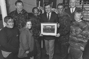 Filey Sea Cadets, fresh from a training exercise, presented local man Chris Ware, centre, with a photo of the unit as thanks for his help back in March 1996. From left, new entry Adam Brammer-Pitt, Lt Cmdr Eddie Temple, new entry Rebecca Duley, A/B Jocelyn Middleton, Chris Ware, L/C Matthew Crosier, Roger Sperry (sea cadets chairman), and Cdt Shaun Artley.