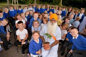 Roop Singh is pictured with Braeburn Year 2 pupils.