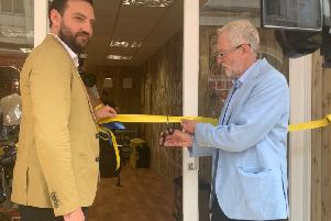 Jeremy Corbyn cuts the ribbon of new Seafood Social cafe.