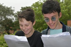 Amy Forrester and Simon Hoyle read their results. PIC: Richard Ponter