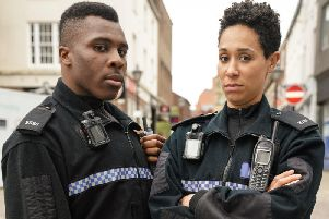 PC Merrick (Olisa Odele)and PC Treeves (Rebecca Scroggs). PIC: BBC/Kieron McCarron