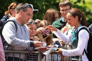 Jessica Ennis-Hill signs autographs after competing in the women's javelin at Loughborough. Photo: Mike Egerton/PA