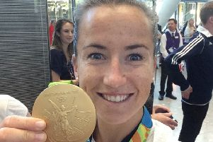 Goalkeepeer Maddie Hinch shows off her gold medal  at Heathrow with Team GB after the women's  hockey team won gold in Rio Olympics