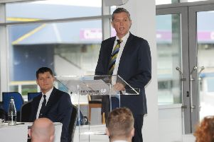 DRIVING YORKSHIRE FORWARD: Yorkshire CCC chief executive Mark Arthur addresses the club's AGM at Headingley on Saturday, with director of ccricket, Martyn Moxon, watching on. Picture: Steve Riding.