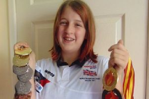 Ellie Greenwood with all the medals she won at the two games