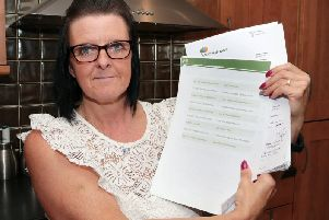 Michelle Kiddy with her correspondence with Scottish Power. Picture: Glenn Ashley/The Star