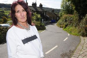 Sue Winger has been calling on the council for the past 22 years to sort out Tofts Lane.Picture: Andrew Roe/The Star