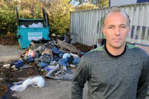 Robert Wall in front of the fly-tipping mess he had to spend all weekend clearing up.
