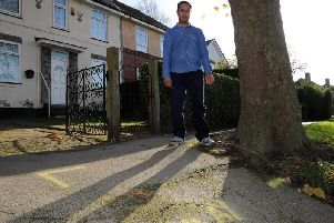 Islam Uddin wants the council to cut down a tree he says is damaging the pavement outside his parents' house.