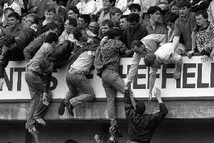 The Hillsborough disaster unfolding.