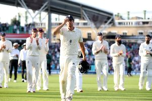 England's Alastair Cook leads the players off at the end of day four