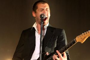 Arctic Monkeys' Alex Turner during their homecoming show at Sheffield Arena last night