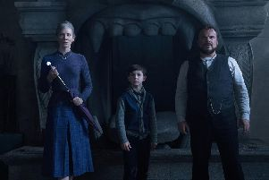 Cate Blanchett as Florence Zimmerman, Owen Vaccaro as Lewis Barnavelt and Jack Black as Jonathan Barnavelt.