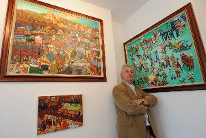 Joe Scarborough with some of his paintings in 2009.