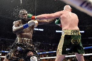 Deontay Wilder and Tyson Fury during the WBC Heavyweight Championship bout at the Staples Center in Los Angeles. Pic: Lionel Hahn/PA Wire
