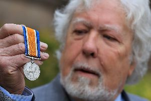 A WW1 Medal discovered by police divers has been reunited with the family. n October, divers from the Yorkshire and Humber Regional Marine Unit were carrying out operational activities in the River Loxley in Sheffield when they found a WW1 medal.''''The medal, which belonged to Stephen Smith, is now being reunited with members of his family after a public appeal for information. Pictured is Julian Cliff from the family with the medal. Picture: Chris Etchells