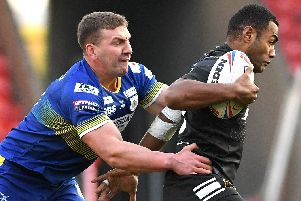 Dons' Russ Spiers gets to grips with Hull's Ratu Naulago.
