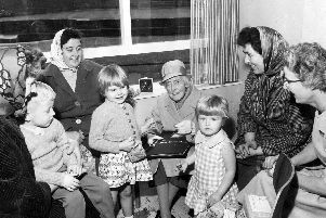 Grace Owen (benefactor of Grace Owen Nursery School, Hague Row, Park Hill Flats) with parents and children at the school at its official opening. On the far right is Miss Cole, its first headteacher, 1963