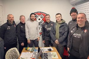Mat Nicholls with members of Rotherham United staff and players