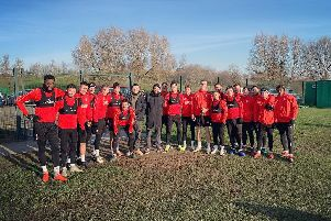Bring Me the Horizon star Mat Nicholls with Rotherham United players and staff