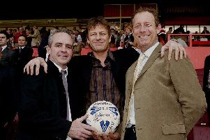 Garry Wright (right) and Telecom Sports FC secretary Andrew Johnstone receiving the Sheffield Sunday Sports League Merit Award on behalf of the club from Sean Bean at Bramall Lane
