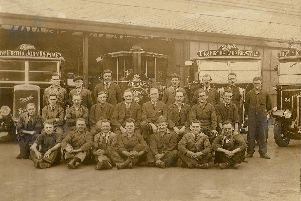 The transport garage of Thomas Firth & John Brown, Princess Street, Sheffield, probably 1931 or 32. 'Reader Robert Grant's father is on the extreme right, dressed in a boiler suit'