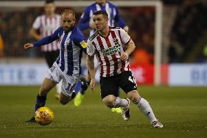 John Fleck of Sheffield United  chased by Barry Bannan of Sheffield Wednesday during the Sky Bet Championship match at Bramall Lane Stadium, Sheffield.  Simon Bellis/Sportimage