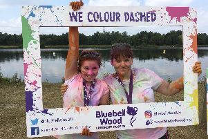 Diane Matthews (right) pictured with her daughter Florence after completing the Bluebell Wood Children's Hospice Colour Dash