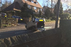 A car on its roof following a crash on Psalter Lane in Brincliffe, Sheffield