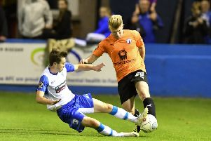 """a Barrow defender slides in on Chesterfield�""""s George Smith: Picture by Steve Flynn/AHPIX.com, Football: Vanarama National League match Barrow -V- Chesterfield at Holker Street, Barrow, Cumbria, England copyright picture Howard Roe 07973 739229"""