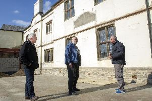 Dave Pickersgill, Ron Clayton and Sean Fogg outside Carbrook Hall, which is being restored ahead of its conversion to a drive-thru Starbucks cafe
