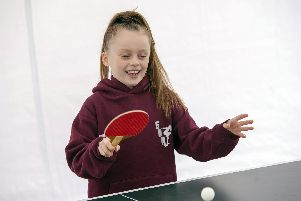 Edie Thomas tryts table tennis at the Family Fun Day at Ridgeway Sports & Social Club ahead of a season of Summer Camps which start on July 22nd