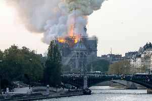 Smokes ascends as flames rise during a fire at the landmark Notre-Dame Cathedral in central Paris on April 15, 2019 afternoon, potentially involving renovation works being carried out at the site, the fire service said. (Photo by FRANCOIS GUILLOT / AFP)        (Photo credit should read FRANCOIS GUILLOT/AFP/Getty Images)