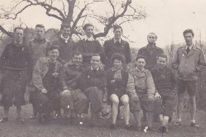 John Ernest Howling and his cycling club in the early 1950s. He is pictured far right in the front row