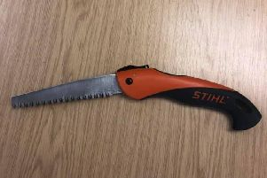 The 'flick-bladed saw' that was found in the man's waistband.