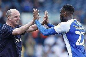 Wigan Athletic manager Paul Cook celebrates with Cheyenne Dunkley after victory over Leeds United: Martin Rickett/PA Wire.