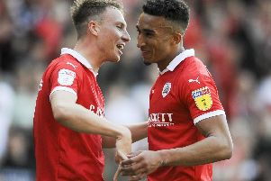 Barnsley v Shrewsbury Town, Skybet League One: Jacob Brown is congratulated by Cauley Woodrow after scoring
