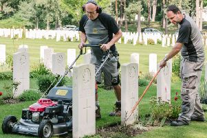 Commonwealth War Graves Commission (CWGC) of staff working on the maintenance on one of the organisation's 23,000 memorial and cemetery sites around the world. CWGC/PA Wire.