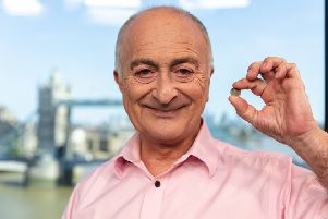 Sir Tony Robinson with the George V silver threepence coin.