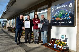 Gerald Townson, Chairman LMCRP, David Alder, Treasurer, and Partnership Officers Catherine Huddleston and Brian Haworth with the Accreditation letter and logo at their Bentham station headquarters.