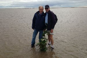 Cedric Robinson (left) with author Lindsay Sutton pictured in Morecambe Bay - literally!