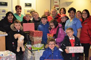 Huggett Suite staff and Morecambe Road School children and staff with the shoeboxes for the appeal.