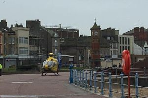 The air ambulance landing on the prom on Monday morning. Photo by Deborah Jane Parker-Bowles.
