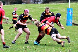 Josh Sheridan tackle, Sam Kyle-Clay (left) and Scott Armstrong (right).