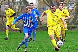 Caton United (yellow) take on Morecambe Royals (blue). Picture: Tony North