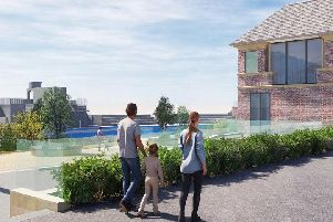 An artists impression of the revamped Grange Lido, in Grange-over-Sands, from Grange Promenade looking in to the newly-refurbished former lido looking towards the historic diving platform, with the entrance pavilion on the right