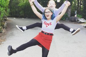 Olivia Evans with her sister Erin.