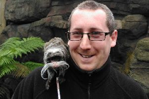 Neil Cook and an Emperor Tamarin monkey.