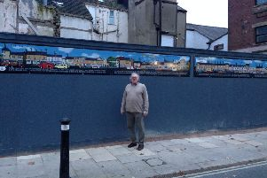 Bob Pickersgill standing in front of his mural in Yorkshire Street.