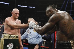 Tyson Fury and Deontay Wilder at the end of their fight. Picture: Esther Lin / Showtime